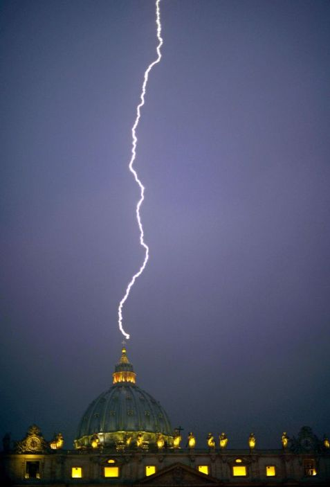 A lightning strikes St Peter's dome at the Vatican on February 11-1704567