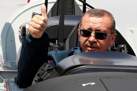 "Turkish Prime Minister Tayyip Erdogan gives a thumbs-up sign from the cockpit of the Turkish Primary and Basic Trainer Aircraft ""Hurkus"" during a ceremony at the Turkish Aerospace Industries in Ankara"