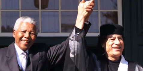 LIBYAN LEADER MUAMMAR GADDAFI VISITS NELSON MANDELA AS LAST OFFICIAL GUEST.